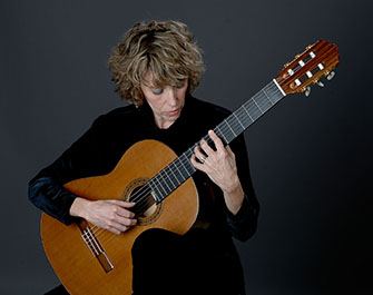 Cindy Egger playing classical guitar